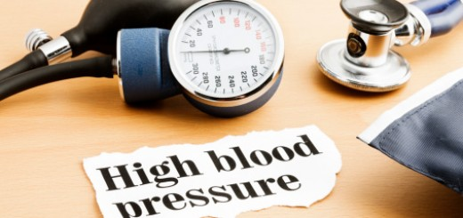 Stethoscope, blood pressure gauge and hypertension headline