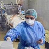 Italian Nurse prepares medicine for covid 19 patient